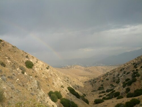 Rainbow over the wind farms as we climb up out of the valley